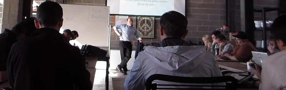 Nicholas Lovell speaking at a GAMESbrief F2P Masterclass